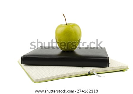 apple on notebooks - stock photo