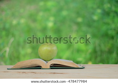 Apple on pile of books. Education concept, back to school.