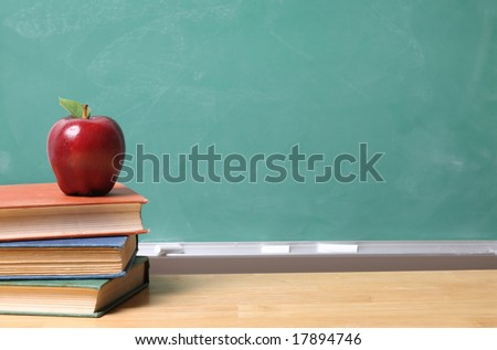 Apple on School Books with copy space on chalk board