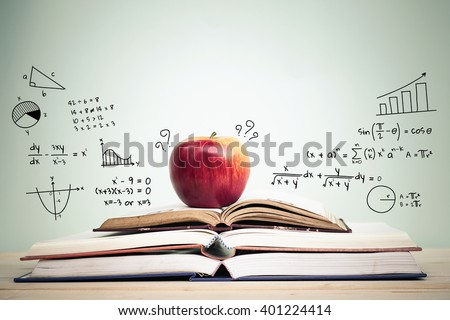 Apple on stack of open books with education doodles and copy space. Education concept. - stock photo