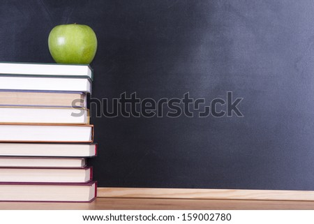 apple on top of stacked books - stock photo