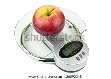 apple on weight isolated on white - stock photo