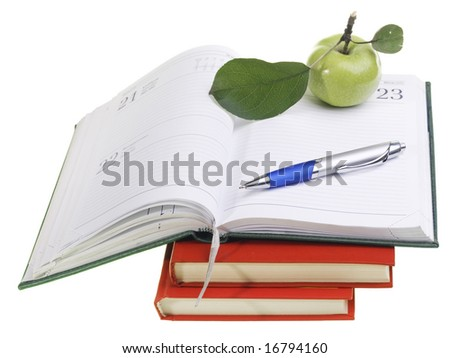 Apple, pe, and books - stock photo