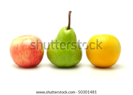 Apple, pear and orange arranged  in a row on white background