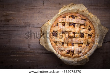Apple/pear pie in a baking paper. - stock photo