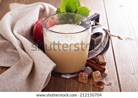Apple pie latte with cinnamon, nutmeg and apple syrup - stock photo