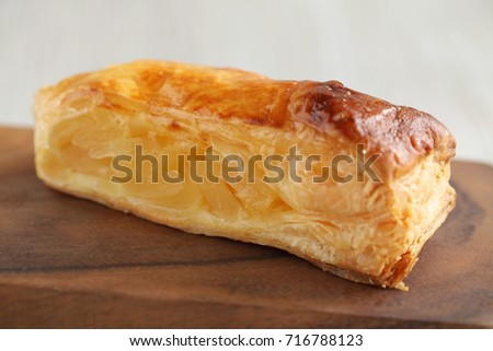 apple pie on a wood cutting board isolated