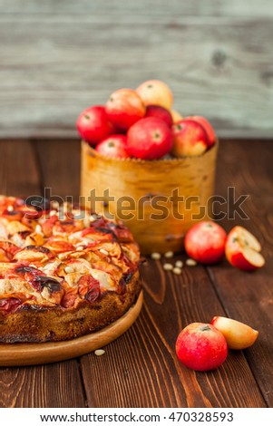 Apple pie on a wooden background