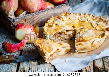 Apple pie on a wooden background, selective focus - stock photo