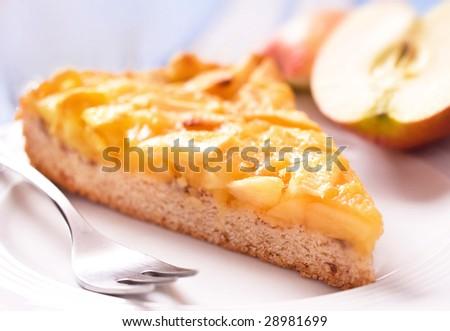 Apple pie on plate, selective DOF - stock photo