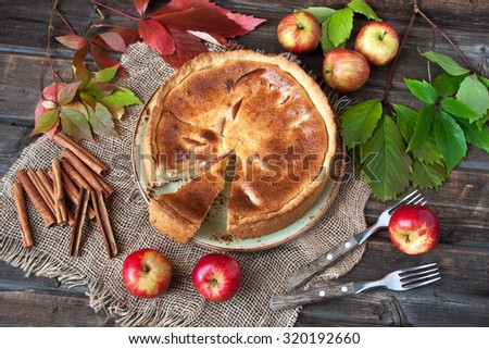 Apple pie on  wooden table - stock photo