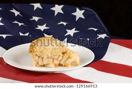 Apple pie.  Slice of apple pie with flag background