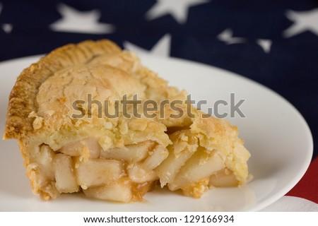 Apple pie.  Slice of apple pie with flag background - stock photo