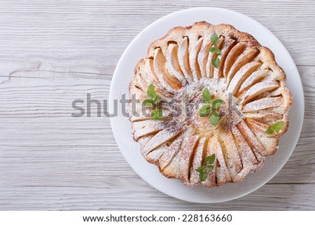apple pie with cinnamon and mint close up on the table. horizontal top view   - stock photo