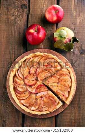 Apple pie with fresh fruits on wooden table, top view - stock photo