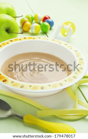 Apple puree in a bowl on the table