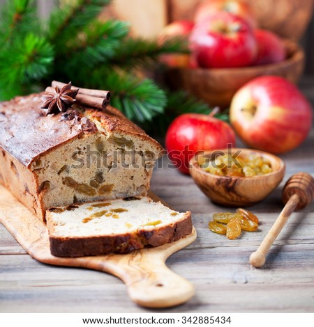 Apple, raisins and cinnamon cake with fresh apples, selective focus - stock photo