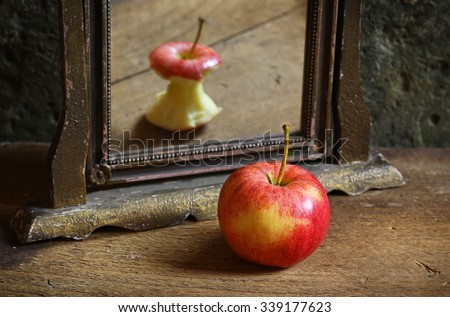 Apple reflecting in the mirror