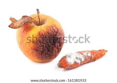 Apple rotten and moldy carrot