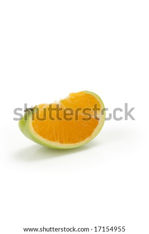 Apple slice with orange in the middle - stock photo