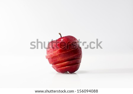 Apple sliced sections. Fruit isolated on white background