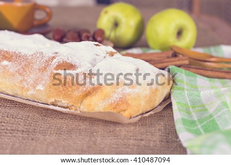 Apple strudel or apple pie  with dates and cinnamon - stock photo