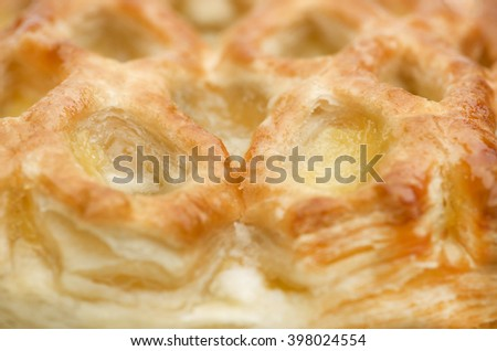 Apple strudel puff pastry close-up. - stock photo