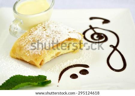 Apple strudel with vanilla cream and mint - stock photo