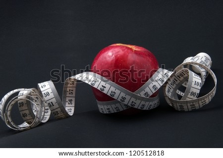 apple surrounded by measurement