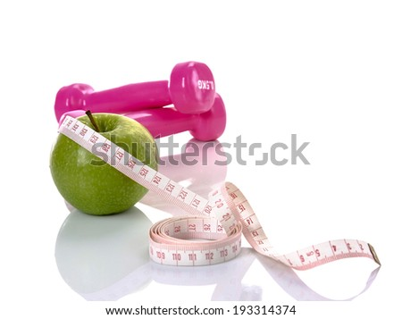 Apple, tape,dumbells lying isolated on white