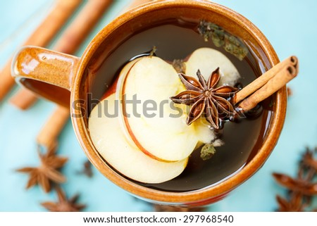 apple tea with spices in a cup - stock photo