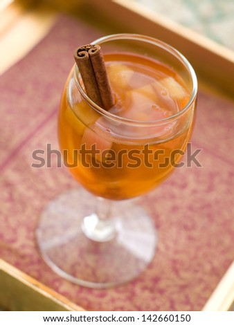 Apple wine or cider with cinnamon stick, selective focus