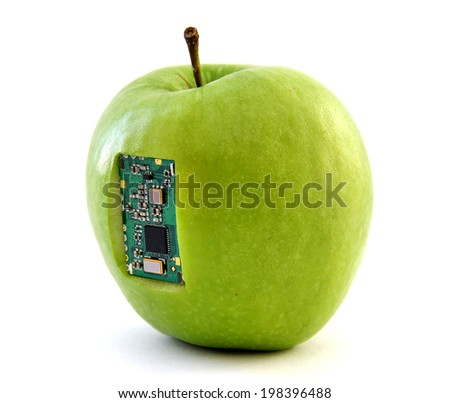 Apple with an integrated circuit - stock photo