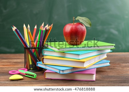 Apple with books and accessories. Back to school concept