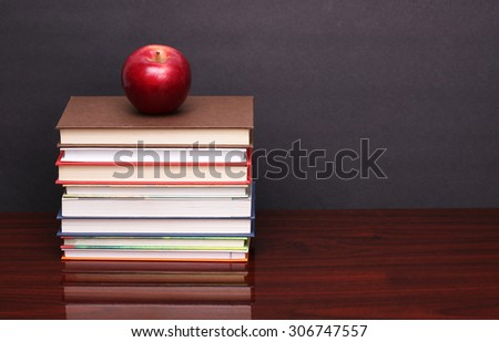 apple with books on wood table