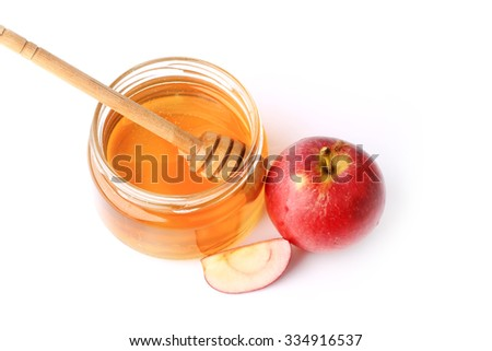 apple with honey isolated on a white background