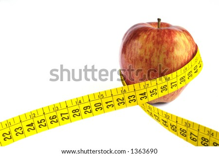 Apple with measuring tape around in white background