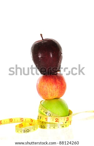 Apple with measuring tape isolated in white - stock photo