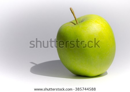 apple with shadow on a gray background