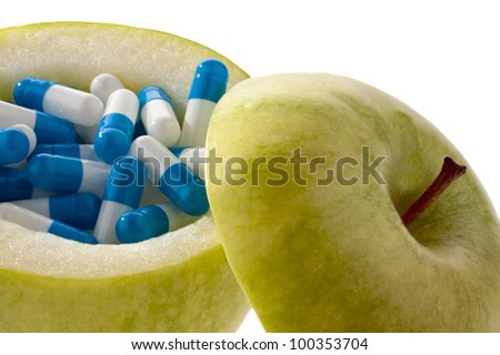 apple with tablets capsules. representative photo of vitamin tablets - stock photo
