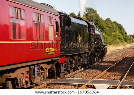 APPLEBY, ENGLAND - AUGUST 25:  The train driver aboard a Stanier Class 8F steam locomotive looks back as his train departs Appleby, England on August 25, 2013, on the Settle to Carlisle railway.