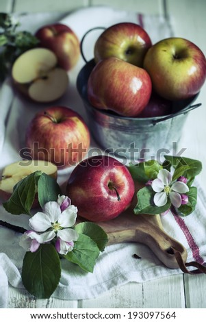 Apples and apple tree flowers in blossom - stock photo