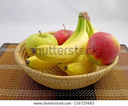 Apples and bananas in a basket.