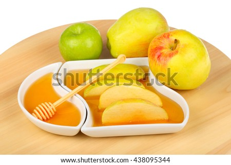 apples and dipping slices of apple in honey for Rosh HaShanah, the Jewish New Year - stock photo