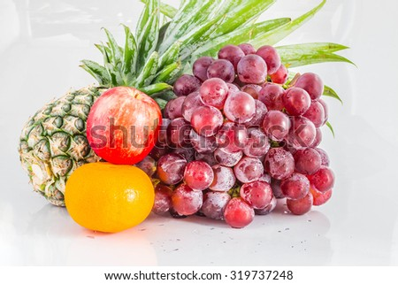 Apples and grapes on isolated background. - stock photo