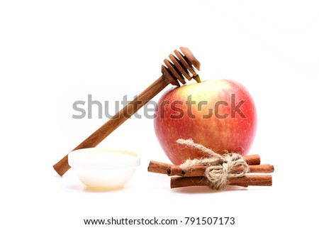 Apples and honey isolated on white background. Composition of apples and rustic cutlery. Set of fruit, wooden honey spoon and cinnamon sticks. Eco nutrition and autumn crops concept.