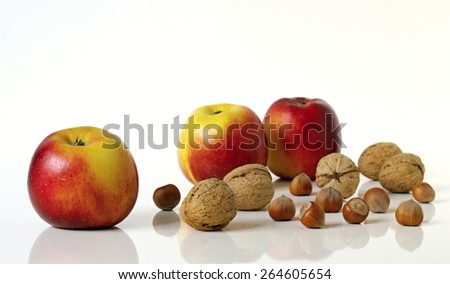 Apples and nuts. Group of healthy fruits and nuts on a white background. - stock photo