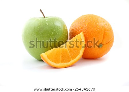 Apples and oranges isolated over a white background - stock photo