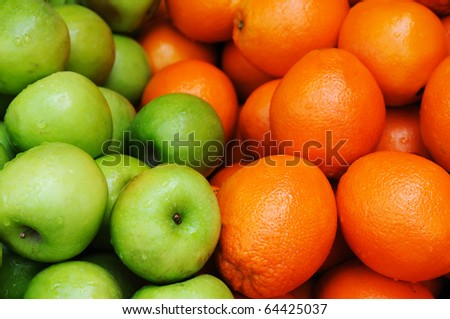 Apples and oranges on the market - stock photo