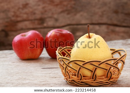 Apples and Pear on old wood floor